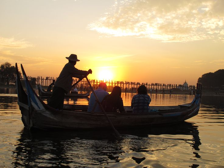 Enjoy a magical A&K Moment at U Bein Bridge in Mandalay, Myanmar and see the sunset in a private boat as you enjoy a chilled glass of Champagne.