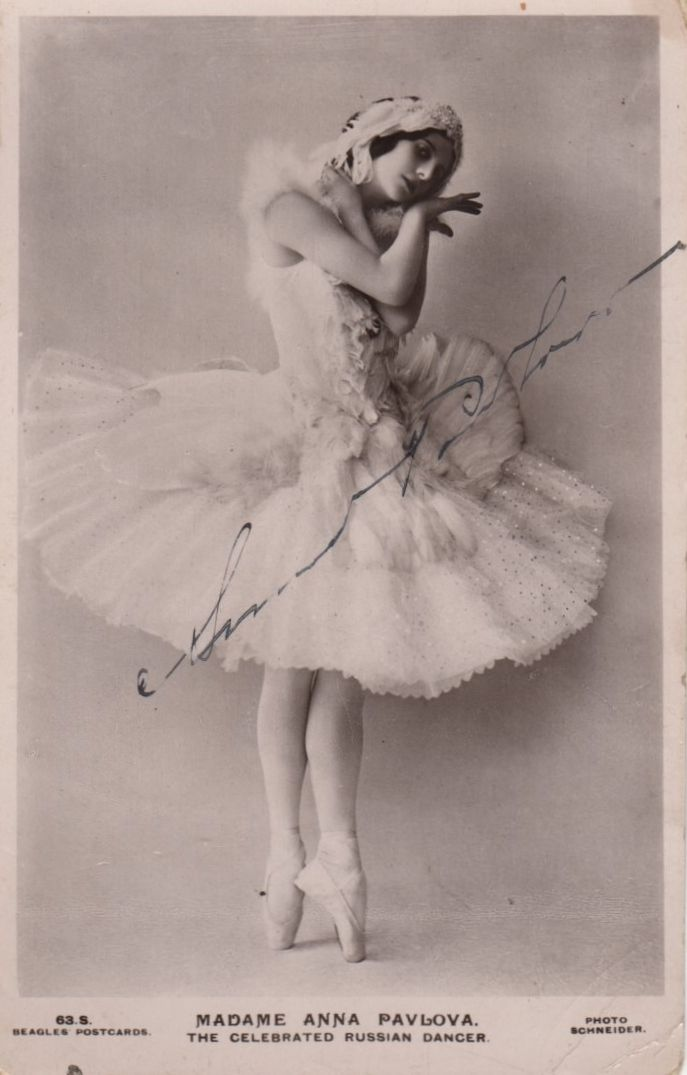 PAVLOVA ANNA: (1881-1931) Russian Ballet Dancer. Vintage signed postcard photograph of Pavlova standing in a full length pose, en pointe, in costume from one of her most famous roles for the pièce d'occasion The Dying Swan. Signed by Pavlova with her name alone in fountain pen ink across a clear area of the image.