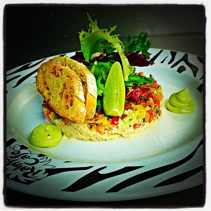 Carnival Crab Salad: Tasty crab mayonnaise resting on a bed of sweet pineapple & mango salsa, topped with crisp mixed leaves, served with ciabatta croutons & avocado purée.
