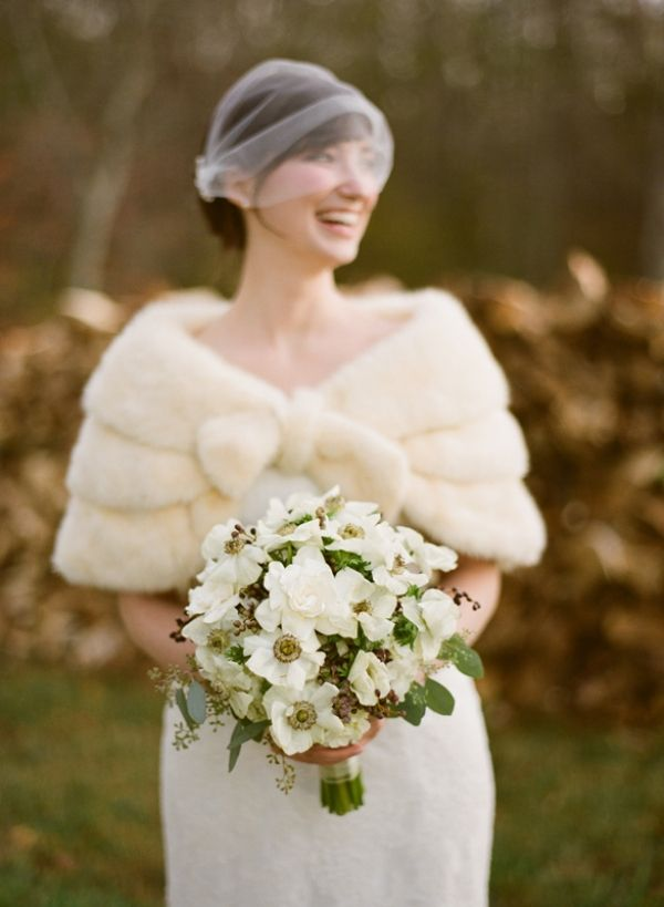 What a gorgeous bride. Her birdcage veil and her faux-fur stole are perfect.
