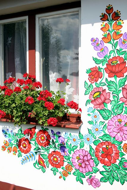 A window box and floral design on a house in Zalipie, Poland. A village about 40 miles east of Krakow, houses are adorned with floral paintings in the style of a famous ceramics artist, Felicja Curylowa, who lived in the village. Today, local women are taught how to paint in her style and anything that can be painted - is painted. June 2011
