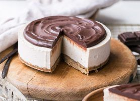This No-Bake Vanilla Bean Cheesecake with Chocolate Ganache is a gluten-free, Paleo + vegan cheesecake made with a creamy cashew filling!