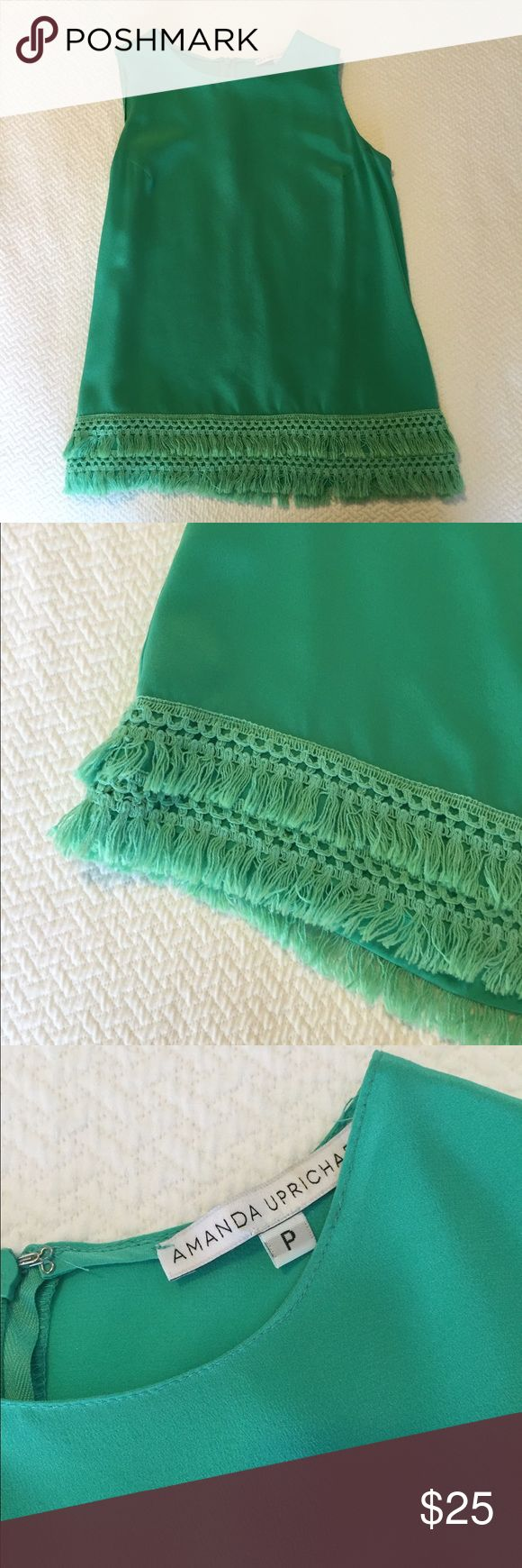Amanda Uprichard silk aqua top with fringe bottom Excellent condition. Worn twice. Size P. Fits 00. Cute double flatter of fringe around the bottom. Super cute with white jeans! Hidden back zipper. Amanda Uprichard Tops Blouses