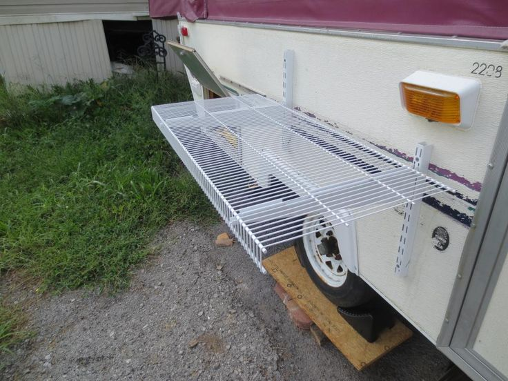 just added this shelf to the outside beside the grill. will hold about 50-75lbs with no issues. lift to remove and store inside pup when tra...