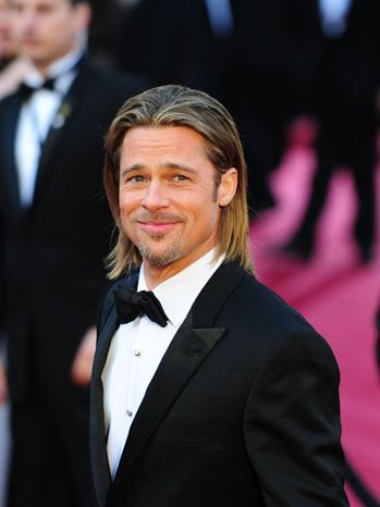 Brad Pitt  2012  Moneyball nominee Brad Pitt, greeted by screaming fans outside the Hollywood & Highland Center, wears a satin peak lapel tuxedo from Tom Ford.