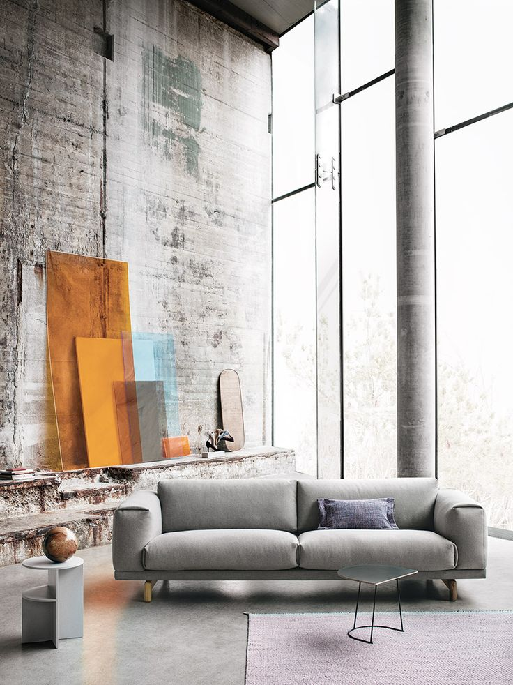 Stunning concrete loft with large windows. Halves side table by Muuto. Stunning Scandinavian furniture design.