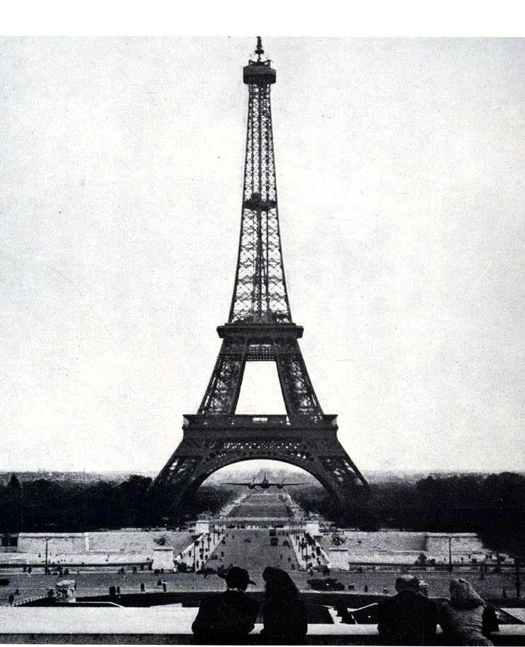 An amazing photograph of an RCAF De Havilland Mosquito slipping under the Eiffel tower's skirt. The pilot has been credited to either the 409th or 410th squadron.