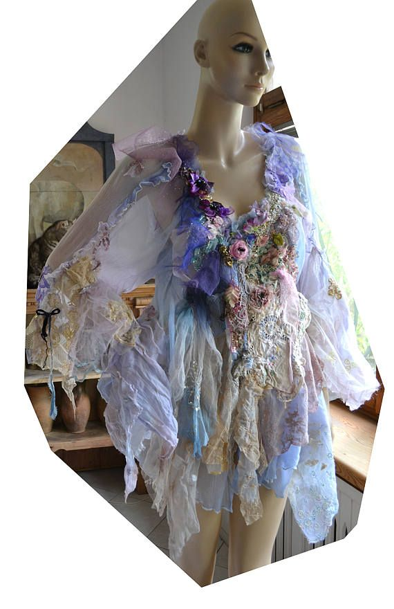 PLEASE CLICK ZOOM below the pictures to see much better quality view, thanks Unique Hand Embroidered Romantic Pale Blue/Periwinkle Transparent Floaty Jacket with wonderful Sleeves with.... Each of my tunics and Dresses though similar in style, is unique and can not be duplicated. They are literally a one-of-a-kind piece of wearable art! Vintage Style with my art of course:) Embroidered with Silk Textiles, Laces, Hand Dyed Old Doilies, Tulle, Silk Roses, Velvet Rose, Antique Miliner...