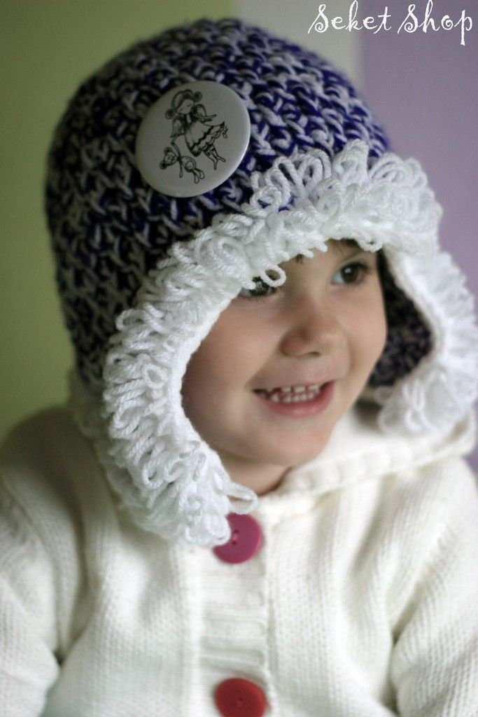 crochet winter hat with ear flap and beautiful badge