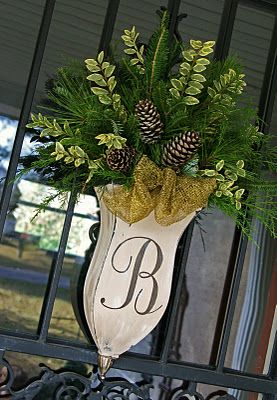 greenery and pine cones in tin vase with monogram