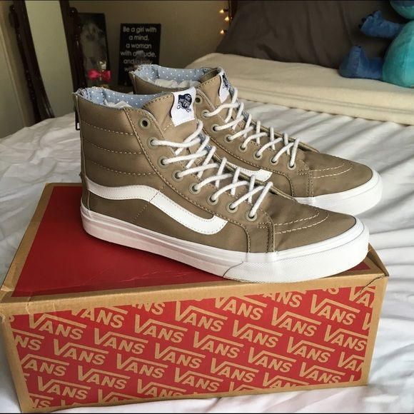 High Top Vans Brand new and clean. Never worn. I got them as a birthday gift, too big on me. Maybe someone else can put them to use! Can be worn by men or women. (Women size: 8.5 Men size: 7) Vans Shoes Sneakers