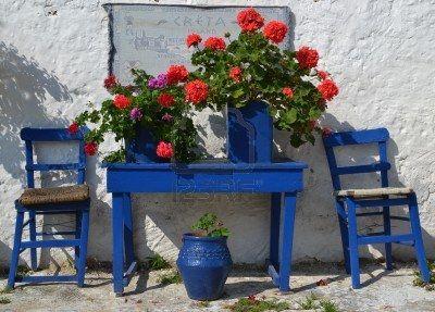 Typical greek courtyard with blue flower pots in Piskopiano on Crete, Greece