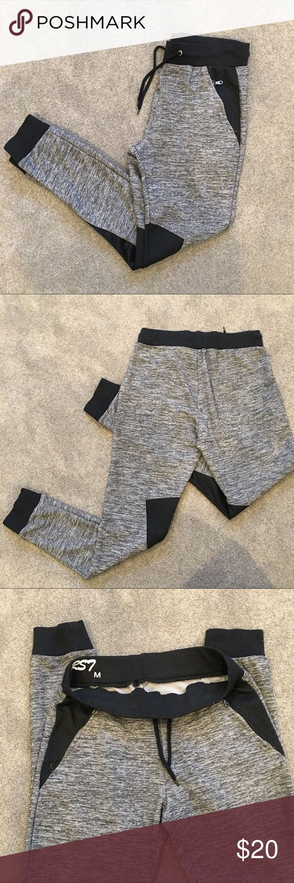 RoyalSeven Men's Joggers Sweatpants Gray/Black Men's joggers sweatpants with two front zipper pockets and one back pocket. No stains, no holes in good condition. Pants Sweatpants & Joggers