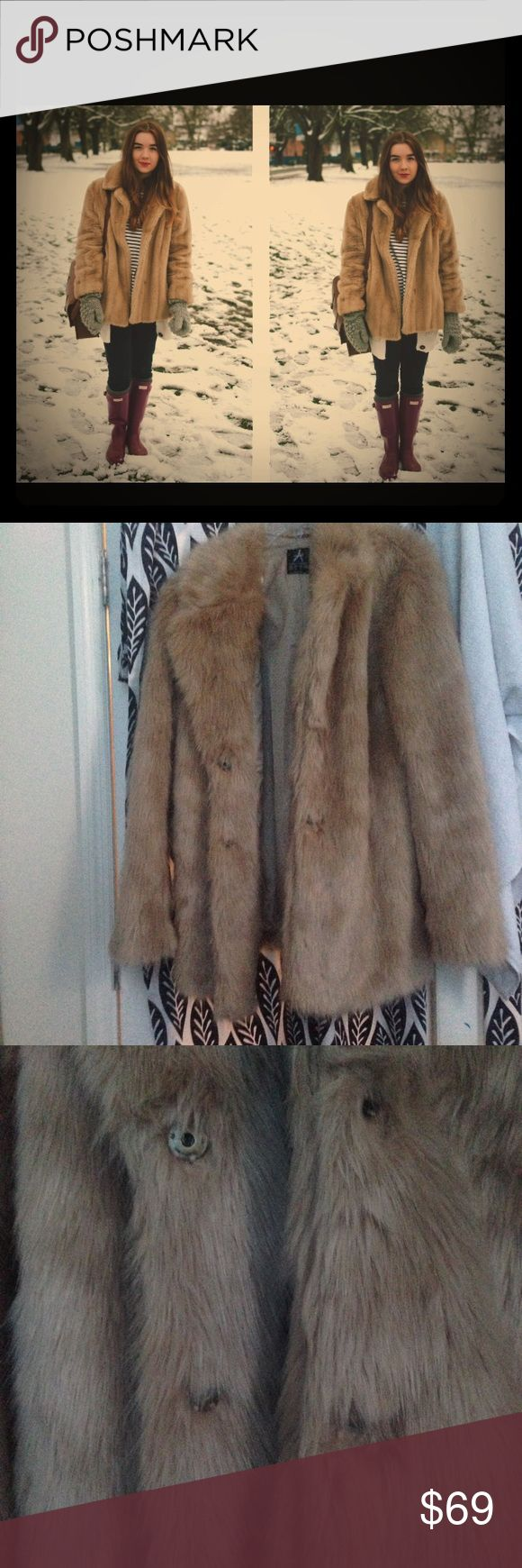 Faux fur caramel jacket size 14 Beautiful warm and soft faux fur Primark Europe brand. very well lined two button closure                                                          Never worn photo is from a blog wrong size for me. Jackets & Coats