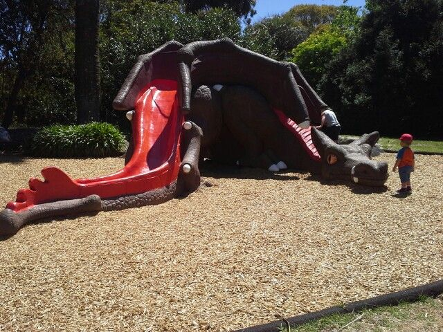 Dragon Slide at Fitzroy Gardens with a large sandpit behind the slide