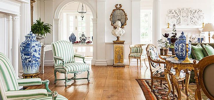 Carolyne Roehm's CT home  With neoclassical architecture such as arches and pilasters as the backdrop, Carolyne doesn't believe her rooms should feel overstuffed. She doesn't even use many rugs; a needlepoint rug in the great room is one of just a few. As a result, every piece of her collection of painted and gilt furniture, most of it from the 18th century, shines.