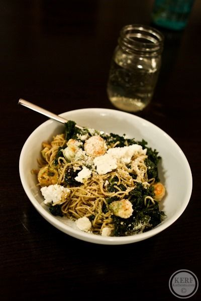pasta cooked with shrimp, kale, goat cheese and parmesan in a pesto ...