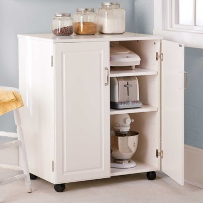 Mobile Kitchen Storage Cabinet provides extra space to keep overflow items such as bakeware and appliances.