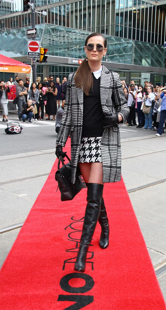 #SQ1xTIFF Flashion Show Look 1. Coat: Theory at Hudson's Bay.  Skirt: Topshop.  TopSandro at Hudson's Bay.  Sunglasses: Sunday Somewhere.  Bag: Philip Lim.  Boots: Nine West. More at shopSQUAREONE.com