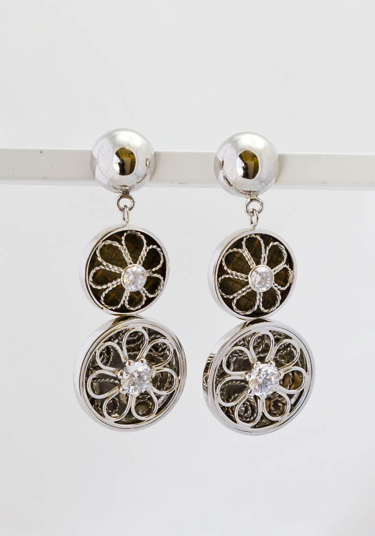Platinum Earrings with Baobab seed inlay.