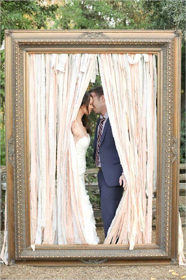 vintage large frame kiss idea // http://www.deerpearlflowers.com/vintage-frames-wedding-decor-ideas/2/