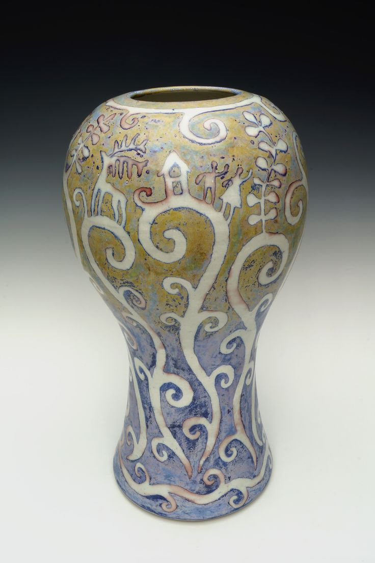 "Stoneware vase with coloured glazes over resist motif. 15.5"" h."