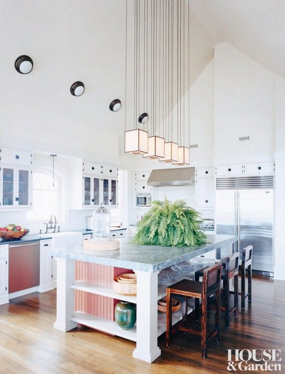 Sage-hued marble lends this spacious Hamptons kitchen an unexpected, country-inflected modernity.