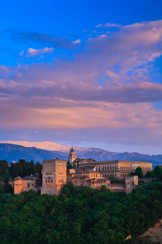 Alhambra with snowy peaks of Sierra Nevada, Granada, Spain