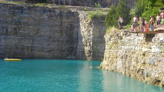 Fugitive Beach, Rolla Mo. A 25 acre site at an abandon Rock Quarry. Beautiful water, sand beach, camp sites, 60' water slide, 15 foot and 20 foot cliff jumps.