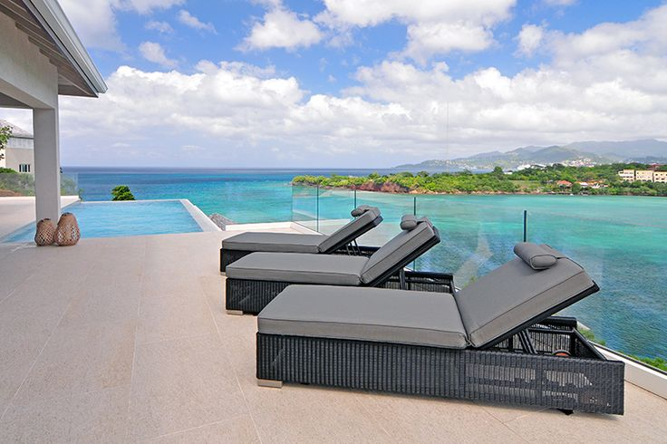 Grenada Villa 2 Pool Deck features an infinity edge pool an comfortable lounge furniture.