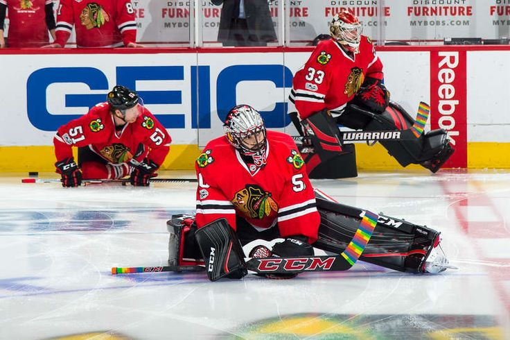 CHICAGO, IL - FEBRUARY 18: (L-R) Brian Campbell #51, Corey Crawford #50 and Scott Darling #33 of the Chicago Blackhawks warm up prior to the game against the Edmonton Oilers at the United Center on February 18, 2017 in Chicago, Illinois. (Photo by Bill Smith/NHLI via Getty Images)