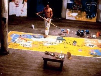 Jean-Michel Basquiat in studio. artist at work at the Toronto AGO exhibits of his work -- a reference to 'black soap' boggles the mind