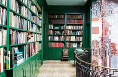 Focus all attention on your prized literary collection by painting the library bookshelves a bold jewel-tone color. We love a historically-inspired shade like ruby or emerald.