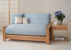 The Panama sofa bed - the base is on solid oak, the futon has a new wool loose cover. http://www.naturalbedcompany.co.uk/shop/sofa-beds/panama-futon-sofa-bed/