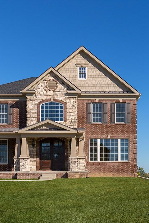 Combination of brick stone exterior this house uses for Brick selection for houses