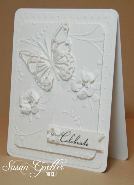 handmade wdding/anniversary card by Susan Goetter ... white on white ... layers of embossing folder texture ... die cut butterfly and flowers with dimension and glittery coating ... wonderful card!