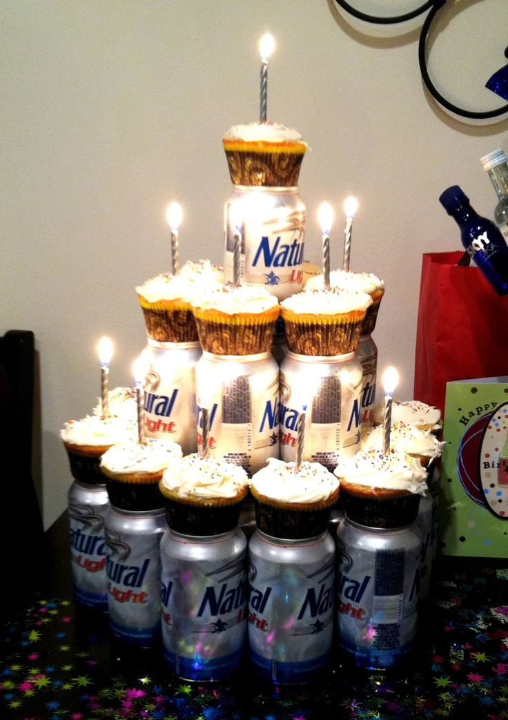beer cake with smirnoff mini cupcakes...top has candle to blow out then shotgun. also encircle each row of beers with streamers