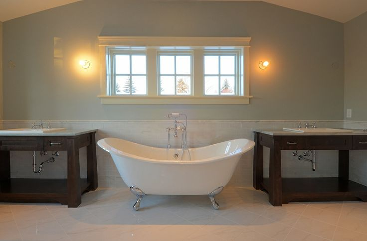 His and her sinks with window and foot claw tub | Calgary