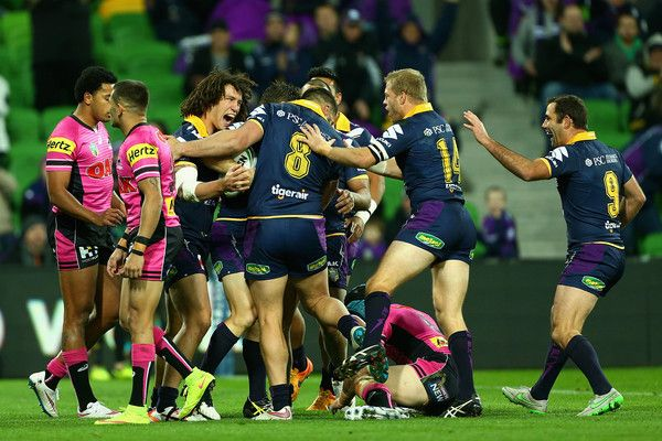 Cooper Cronk Photos - Cooper Cronk of the Storm looks on as Cameron Smith of the Storm speaks during the round 19 NRL match between the Melbourne Storm and the Penrith Panthers at AAMI Park on July 17, 2015 in Melbourne, Australia. - Cooper Cronk Photos - 655 of 1688