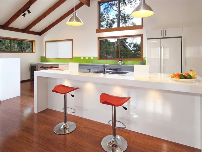 Corian Antartica Bench top with Miele induction cook-top and Miele steamer Oven.  www.kitchensbrisbane.com