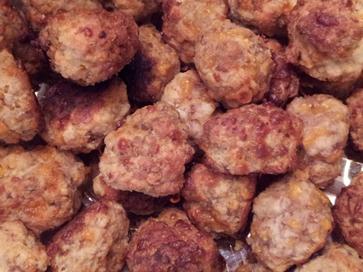 My original recipe for Sausage Cream Cheese Balls- so much better than the regular sausage balls! Here is the recipe: 1 lb. sausage (you can either use hot or regular, I prefer half and half)  4 oz. cream cheese, softened, 1 1/2 cup Bisquick,  1/4 cup water,  8 oz shredded sharp cheddar cheese.  Mix all ingredients together (I use my KitchenAid mixer but by hand is fine).  Roll into 1 - 1 1/2 inch balls. Bake @ 400 degrees on parchment lined baking sheet for 20-25 minutes or until golden…