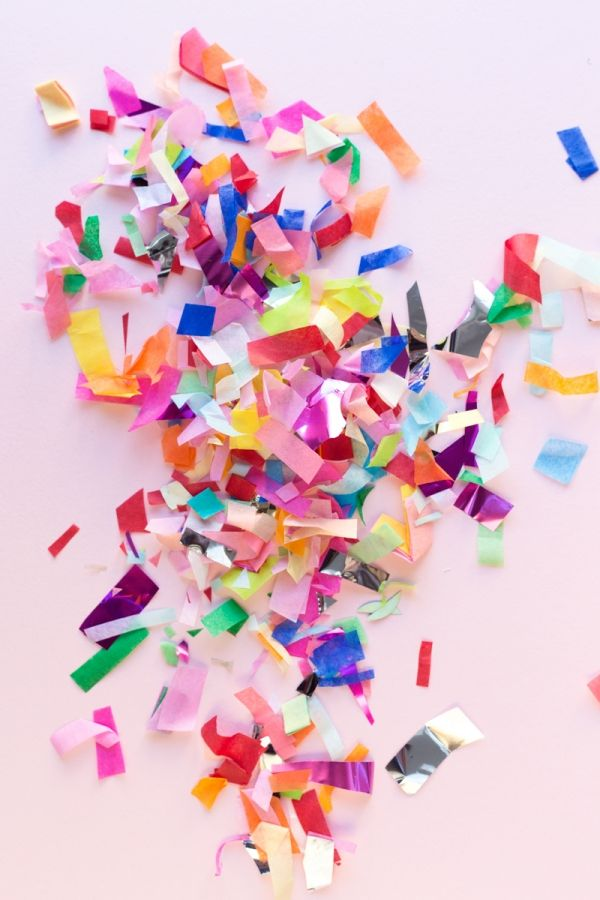 Cut up tissue + wrapping paper from gifts to make colorful repurposed confetti!