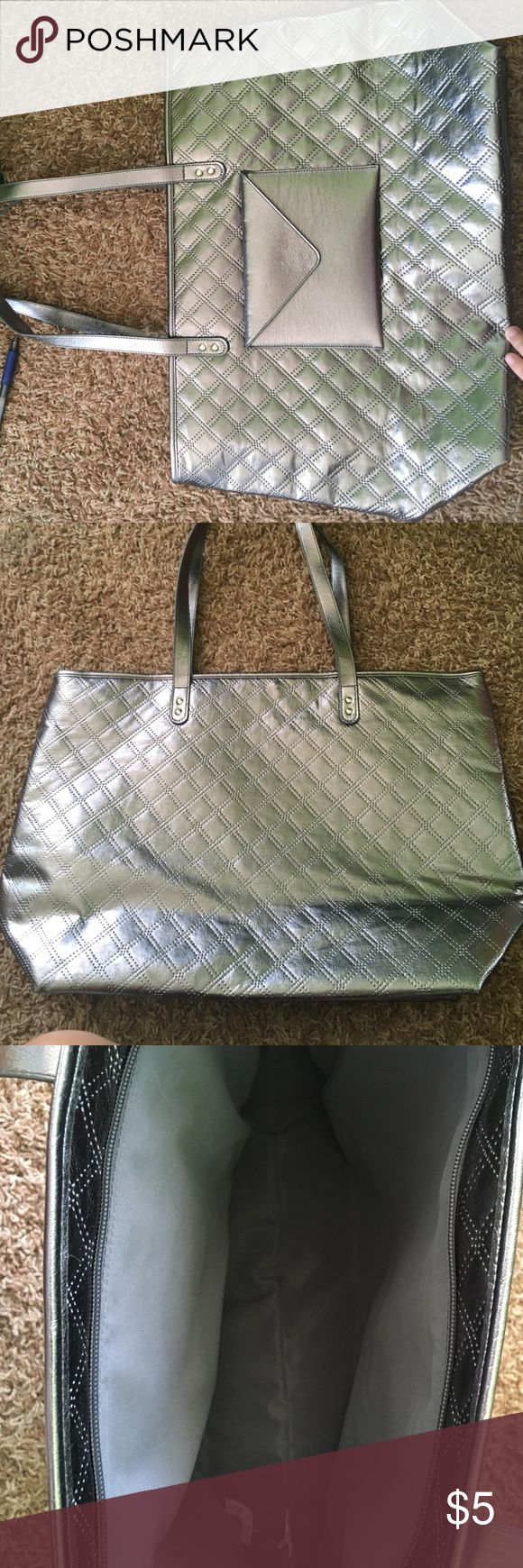 Silver Tote Bag Shiny silver tote bag I originally got from bath and body works. Brand new with tags. Comment if interested in measurements. Bags Totes
