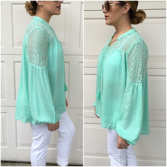 Last largeGorgeous mint tops Solid long sleeve tops with lace and self tie at neckline.  Large (12/14). Price is firm unless bundled. 100% rayon Tops