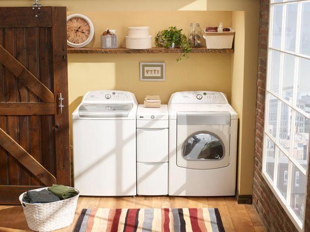 Compact units and between-machine storage bins make for a concealable laundry room.
