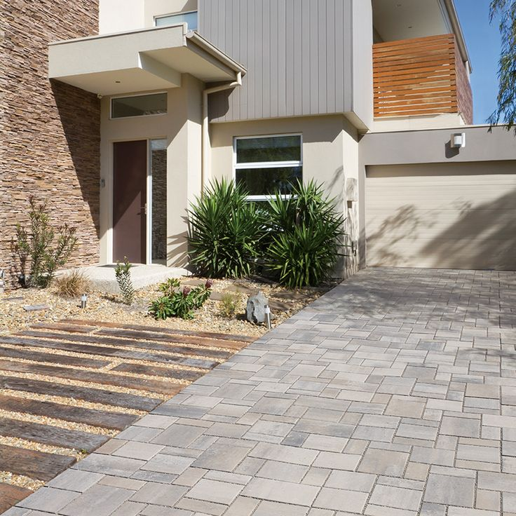 Driveway and walkway landscape. Project application using Presidio pavers. Color: Enviro Midori Champagne by Oaks Landscape Products.