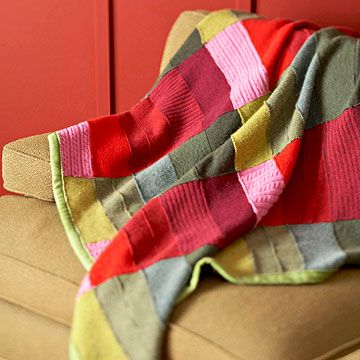 Recycled sweater throw.