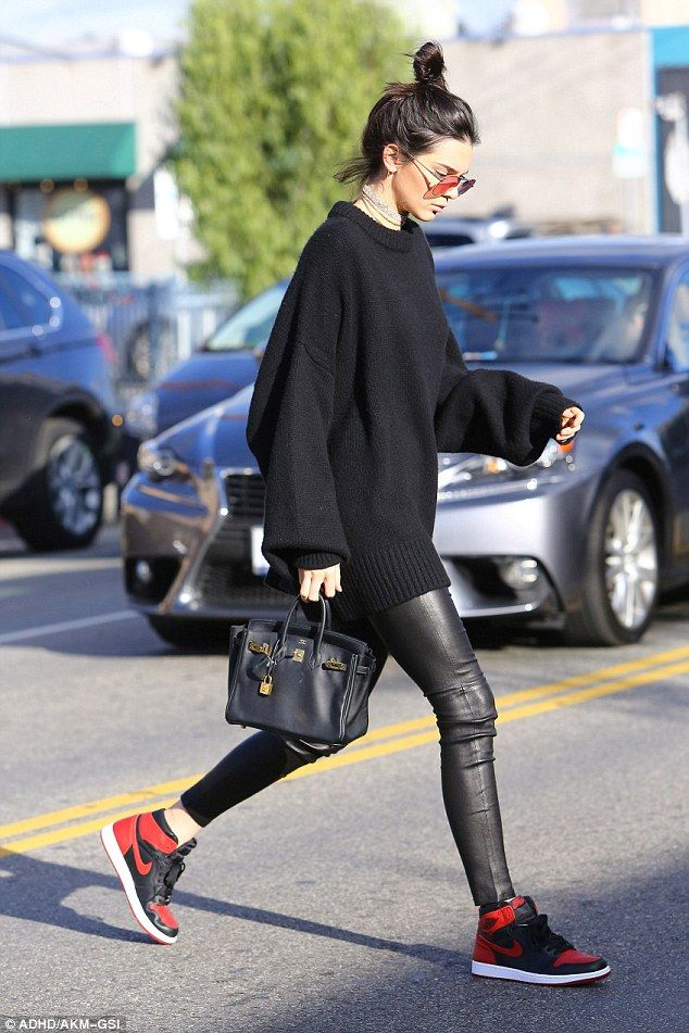 Casual chic: Kendall Jenner turned the street into a fashion runway as she was spotted hea...