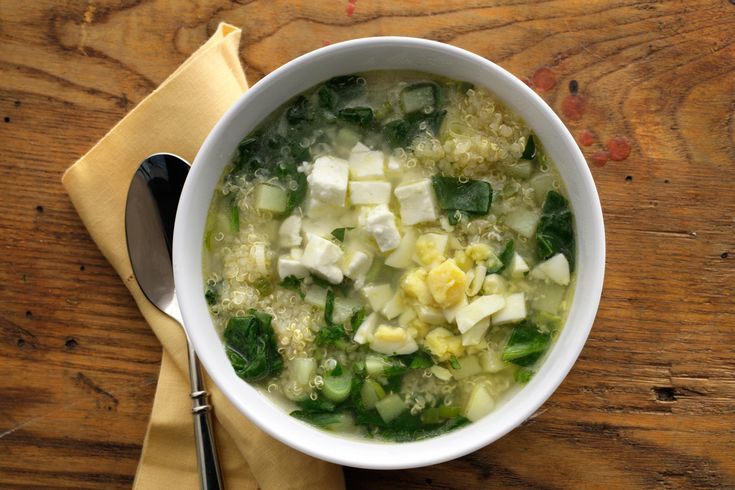 Hearty quinoa, vegetables, and feta cheese stand in for the cream and seafood in this healthy vegetarian soup recipe.