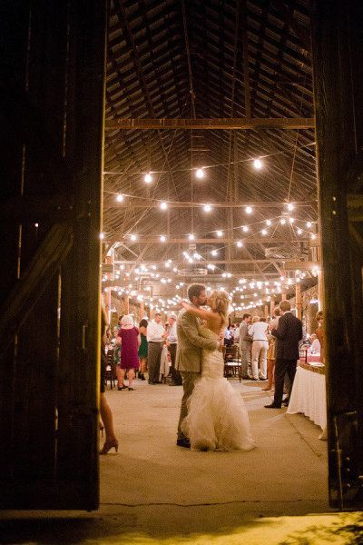 Dancing the night away- rustic barn wedding with twinkle lights